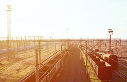 Railway landscape with many old railroad freight cars on the rails. Classic sunny day on the railroa. D Stock Images