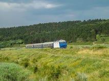 Railway landscape from Romania. Romanian interregio train Iasi-Bucuresti . CFR Train, Romanian trains Royalty Free Stock Image