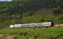 Railway landscape from Romania. Romanian interregio train Bucuresti - Iasi. CFR Train, Romanian trains Stock Photo
