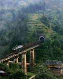 Railway landscape ,southwest mountain area,China. A freight train through the tunnel, Sanjiang region(a southwest mountain area in Guangxi province),China royalty free stock images