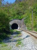Railway leading to the dark tunnel entrance Stock Photo