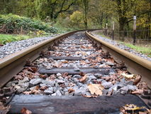 Railway line. Old railway line trough a forest in autumn Stock Photo