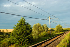 Railway line. And summer golden fields Stock Photography