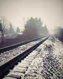 Railway line. In foggy winter morning Royalty Free Stock Image