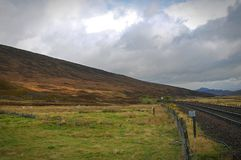 A railway line disappearing into the distance. Near Dalwhinnie in the highlands of Scotland Royalty Free Stock Photo