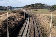 Railway line for high-speed rail trains. Railway line and electr. Ic traction, which is located above the track. Season of the spring Stock Photography