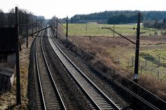 Railway line for high-speed rail trains. Railway line and electr. Ic traction, which is located above the track. Season of the spring Royalty Free Stock Photo