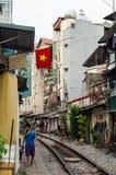 Railway line passing between narrow buildings in the Old Quarter of Hanoi Stock Photo