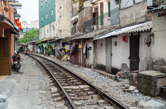 Railway line passing between narrow buildings in the Old Quarter of Hanoi Stock Images