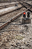 Railway line with red light alert royalty free stock photo