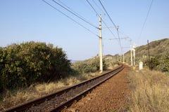 Railway Line Running Between Vegetation Alongside Indian Ocean Royalty Free Stock Photography