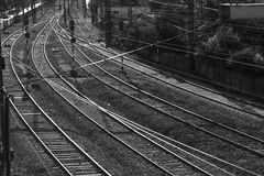 Railway lines. Black and white photograph of train tracks shining in the evening light stock photography