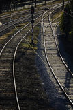 Railway lines. Black and white photograph of train tracks shining in the evening light stock photos