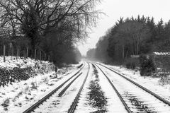 Railways in the Snow. Railway lines disappear into the distance in snowy conditions Royalty Free Stock Photography