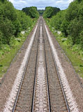 Railway Lines in the distance. A reflective image of a pair of railway lines vanishing in the distance Stock Photos