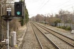 Green light on train rails stock image