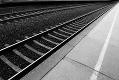 Railway lines at a train station disappearing into Stock Images