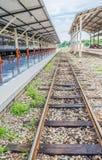 Railway lines travel through a railway station Stock Photo