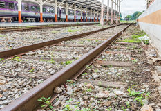 Railway lines travel through a railway station Stock Photos