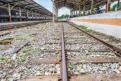 Railway lines travel through a railway station Royalty Free Stock Photo