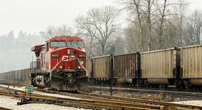 Railway Locomotive and Freight Cars Stock Photo