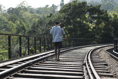 Railway with man walking. Ella, Sri Lanka. Railway with farmer walking in the middle. Ella, Sri Lanka stock photography