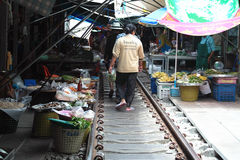 Railway Market, Train Market, Bangkok Thailand. As a Thai Railways train approaches all the vendors at the famed Mae Klong Railway Market in Samut Songkhram Royalty Free Stock Images
