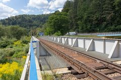 Railway metal bridge near road. And forest Royalty Free Stock Photo