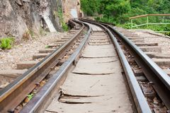Railway beside mountain Royalty Free Stock Photos