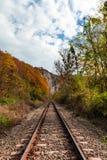 Railway through the mountains autumn time stock photo