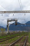 Railway with mountains in the background. View of a straight railway heading to the mountains in the background Royalty Free Stock Photos