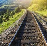 Railway in the mountains. Stock Photos