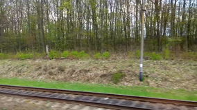 Railway from moving train window stock video footage