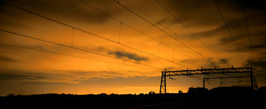 Railway By Night. A night image of the overhead live wire railway at Rugby in England stock photography