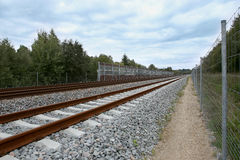 Railway with noise damping wall. Stock Photography