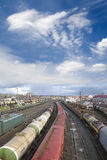 Railway. Oil cistern. Railway station. Cargo transportation of goods by rail. Train with storage tank. Blue sky and white clouds Stock Photo