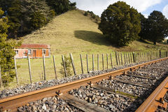 Railway and old cottage. Royalty Free Stock Photography