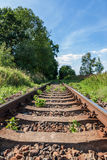 Railway old rusty track detail with landscape Stock Image