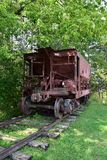 Antique ore cart from a rail road. Railway ore car on display in outdoor park royalty free stock photo