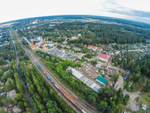 The railway passes through the provincial town. View of the railway in the village Maksatikha Royalty Free Stock Image