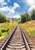 Railway passing through a beautiful landscape in the summer Stock Photo