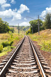 Railway passing through a beautiful landscape in the summer Stock Photos