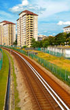 Railway passing through housing area Stock Photos