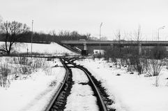 Railway. The picture monochrome. It`s spring. Photo showing the path of the railway somewhere in Russia. Immense space. A lone wagon in the distance stock image
