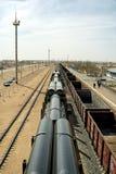 Railway platform laden pipes. Stock Photos