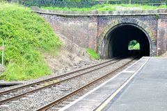 railway platform and tunnel in England Royalty Free Stock Images