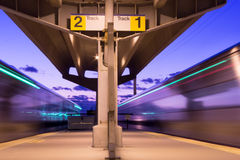 Railway Platform at Twilight. Long exposure photo of traffic on 5th Avenue, Manhattan at night royalty free stock photos