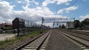 Railway. Poland. A view of the railway line, electric traction and acoustic screens Stock Photography