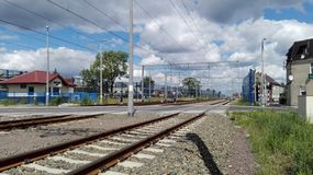 Railway. Poland. A view of the railway line, electric traction, acoustic screens and the railway level crossing Stock Images