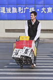 Railway porter in Dalian, China. DALIAN-CHINA-OCT. 14, 2012. Railway porter on Oct 14, 2012 in Dalian. The term 'coolie' was also used in China for porters Stock Photography